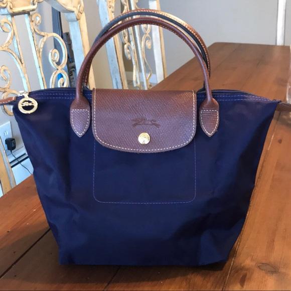 30766444eba4b3 Longchamp Handbags - Longchamp le pliage small top handle bag